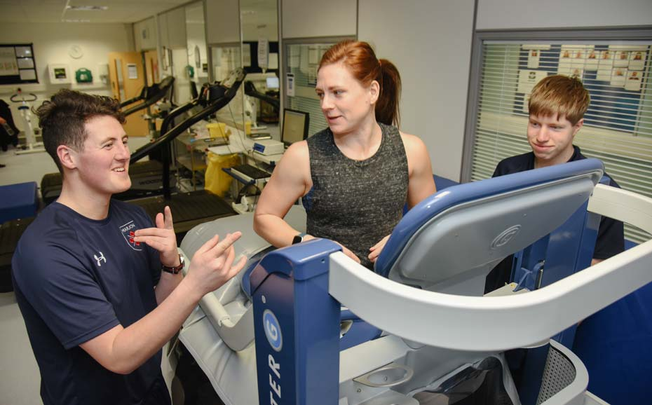 Three students in a practical session on the anti-gravity treadmill