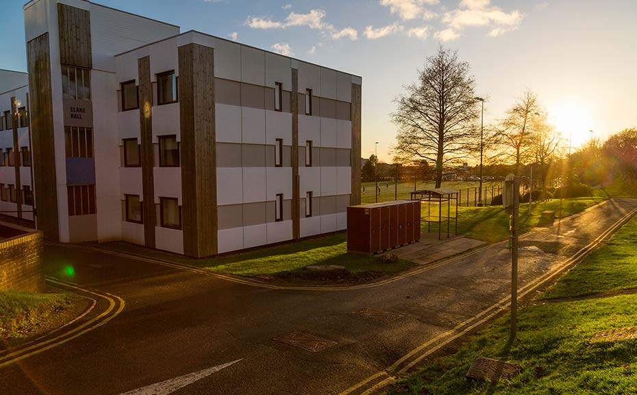 student halls at sunset with a view of the 3g pitch